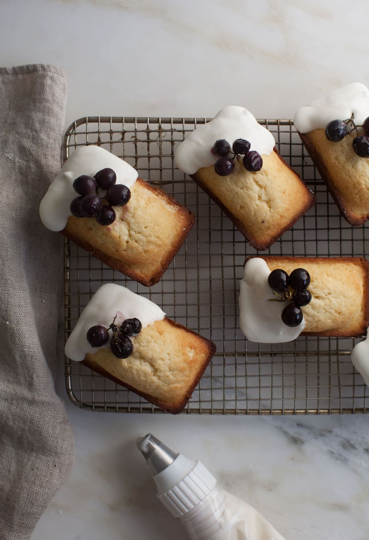 Mini Pound Cakes with Lebneh Frosting and Roasted Grapes
